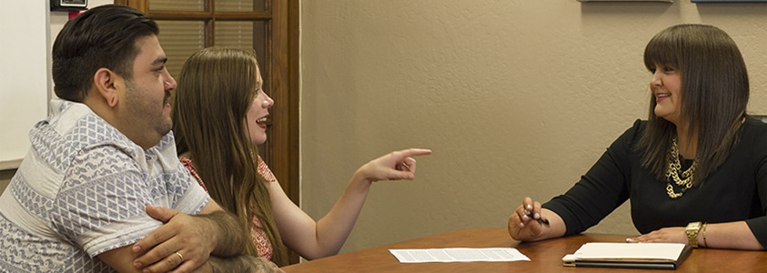Attorney Chandra Farris meets with clients for a free consultation