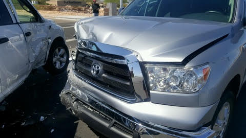 A truck with damage to the front end