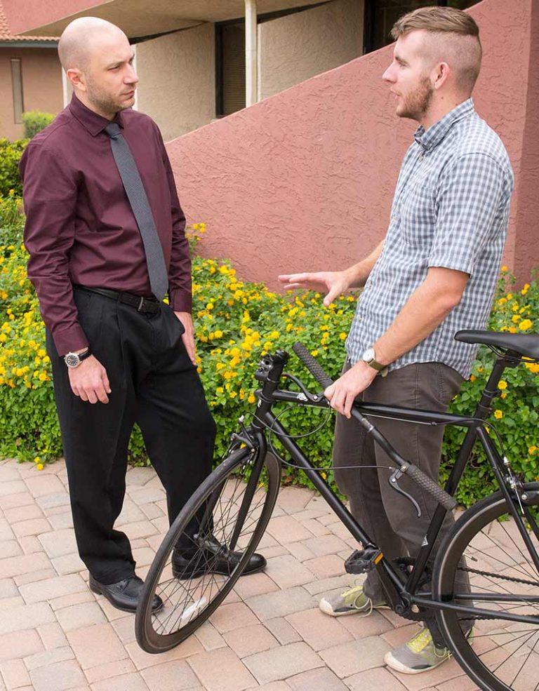 Kel Vrana discussing a bike accident